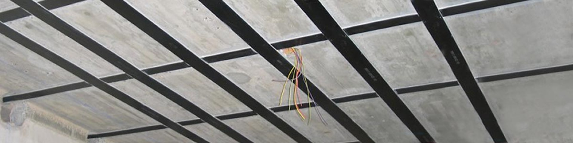 Strengthening of concrete structures with CFRP strips